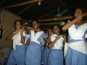 Girls dancing at slum school in Bangladesh.