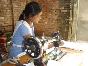 Developing seamstress skills at a school for girls in Dhaka, Bangladesh.