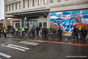 Police escorts in front of the Seattle detention center.